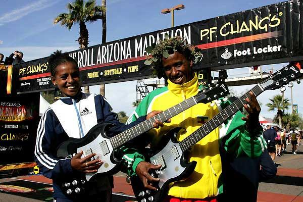 Shitaye Gemechu and Terefe Yae pose with guitars after their victories in the Rock n'Roll marathon (Victah Sailer)