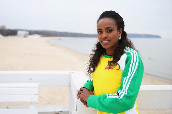 Genzebe Dibaba on the pier with beach in background ahead of Sopot 2014 ()