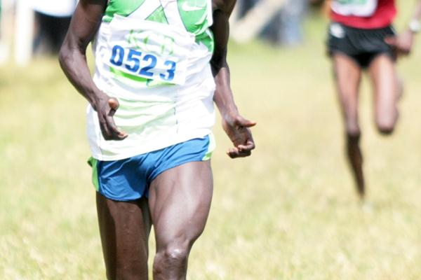 Joel Kemboi Kimurer sprints to the finish line to win the 12-kilometre race at the 2009 Kenya Police National Cross Country Championships at the Ngong Racecourse in Nairobi. (Elias Makori)