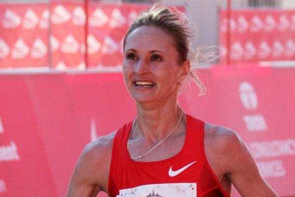 All smiles - Liliya Shobukhova takes her third straight Chicago Marathon title (Getty Images)
