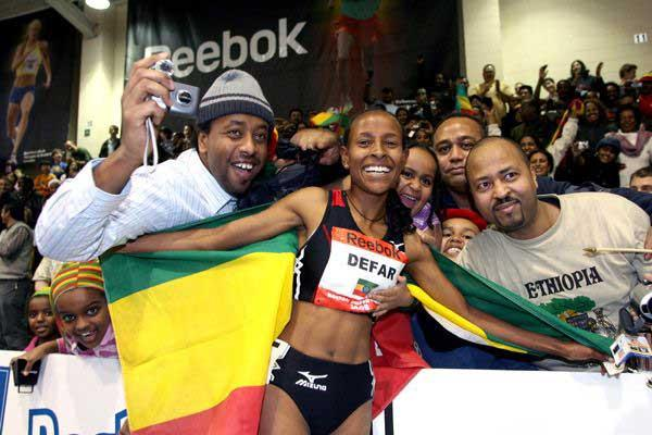 Meseret Defar with fans after her world best in Boston (Victah Sailer)