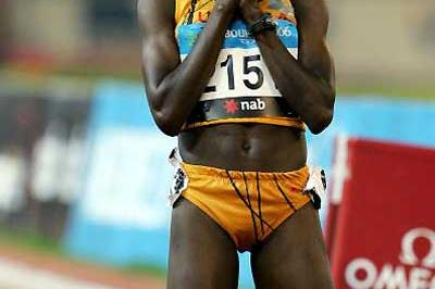 World champion Dorcus Inzikuru of Uganda offer prayers of thanks after her Steeplechase victory - Melbourne (Getty Images)