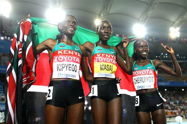 Sally Kipyego of Kenya, Linet Chepkwemoi Masai of Kenya and Vivian Jepkemoi Cheruiyot of Kenya celebrate after the women's 10,000 metres final during day one (Getty Images)