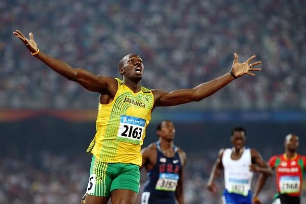 Usain Bolt celebrates after breaking the 200m world record (Getty Images)