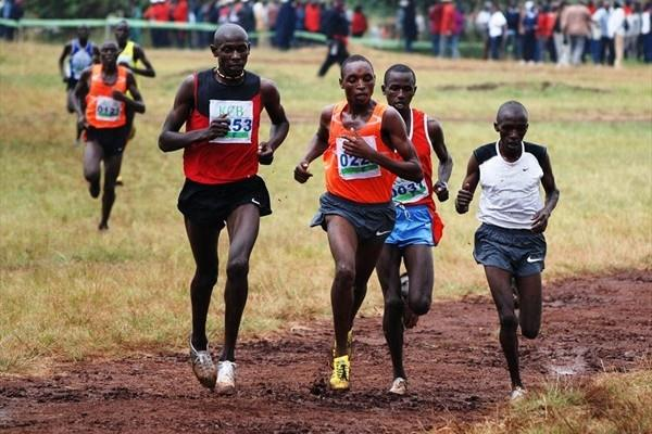 Charles Chebet Chepkurui (far right) en route to winning the Junior Men's 8k title (Ricky Simms)