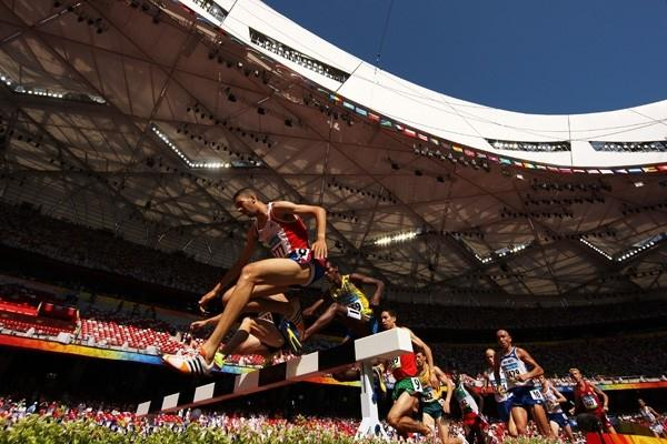 Mahiedine Mekhissi-Benabbad and Mustafa Mohamed negotiate the barriers in the men's steeplechase heats (Getty Images)