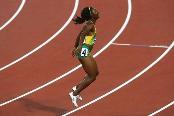 Shelly-Ann Fraser jumps up and down in utter disbelief at her 10.78 victory (Getty Images)
