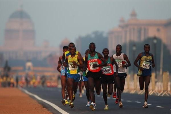 John Kelai of Kenya (1571) heads the leading pack in the Men's Marathon at the Commonwealth Games in Delhi, India (Getty Images)