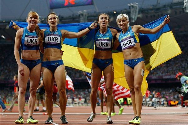 Bronze medalists Olesya Povh of Ukraine, Hrystyna Stuy of Ukraine, Mariya Ryemyen of Ukraine and Elyzaveta Bryzgina of Ukraine celebrate after the Women's 4 x 100m Relay Final of the London Olympic Games on 10 August 2012 (Getty Images)
