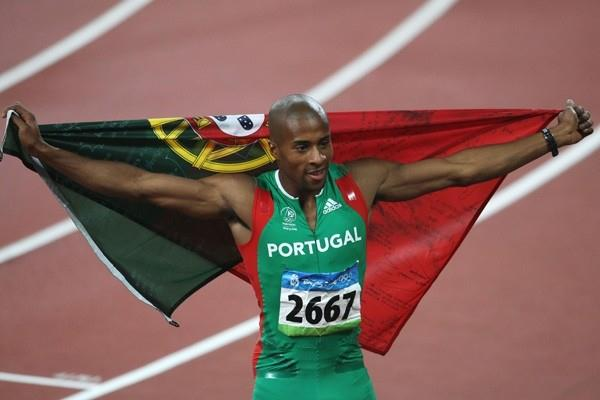 Nelson Evora of Portugal produces his best jump of the year to win the Olympic triple jump title (Getty Images)
