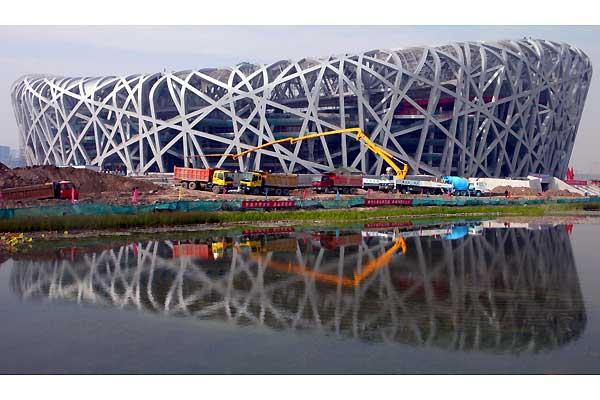 Beijing Olympic National stadium, also known as the Bird's nest, is seen reflecting in a pond, 10 October 2007. The stadium will host the Athletics events and the Football final of the Olympic Games hosted in the Chinese capital (AFP / Getty Images)
