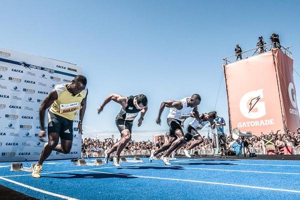 Usain Bolt racing on Copacabana Beach, Rio 2013 (Thiago Diz)