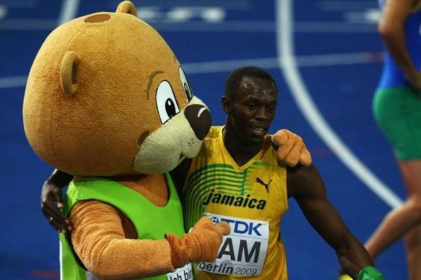 Jamaica's Usain Bolt celebrates winning the gold medal in the men's 4x100m with Berlino the Bear at the 12th IAAF World Championships in Athletics (Getty Images)