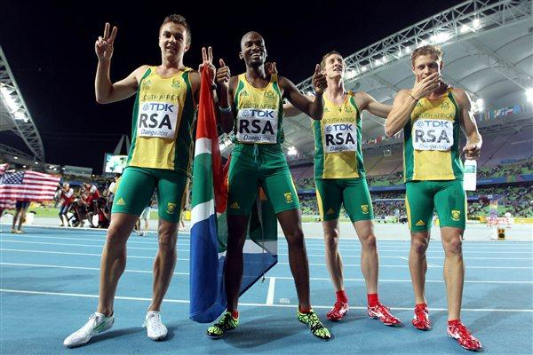 Shane Victor, Ofentse Mogawane, Willem de Beer and L.J. van Zyl of South Africa celebrate second place in the men's 4x400 metres relay final  (Getty Images)