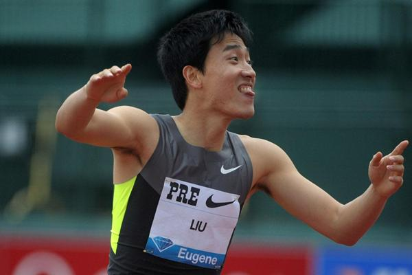 Liu Xiang celebates his stunning 12.87 windy victory in Eugene (Kirby Lee - Image of Sport)