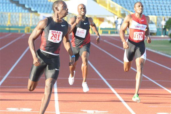 Rondel Sorrillo, left, wins the National Championship men's 200m final in 20.16 seconds, in Port of Spain  (Anisto Alves / Trinidad Express)