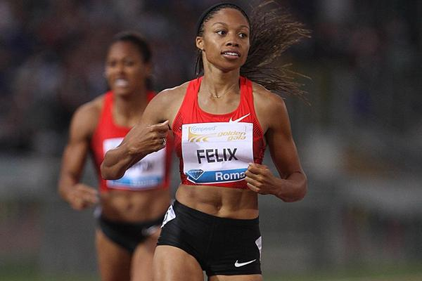 Allyson Felix crosses the line in the 400m in Rome (Giancarlo Colombo)