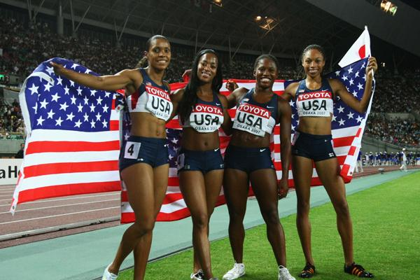 Torri Edwards, Mikele Barber, Lauryn Williams and Allyson Felix of USA celebrate victory in the Women's 4 x 100m Relay Final (Bongarts/Getty Images)