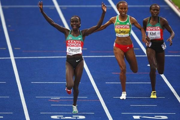 Vivian Cheruiyot of Kenya crosses the line to win the gold medal in the women's 5000m final at the 12th IAAF World Championships in Athletics (Getty Images)