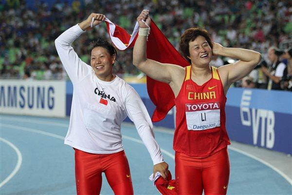 (R-L) Gold medallist Li Yanfeng of China celebrates with Tan Jian of China (L) after victory in the women's discus throw final competes  during day two (Getty Images)