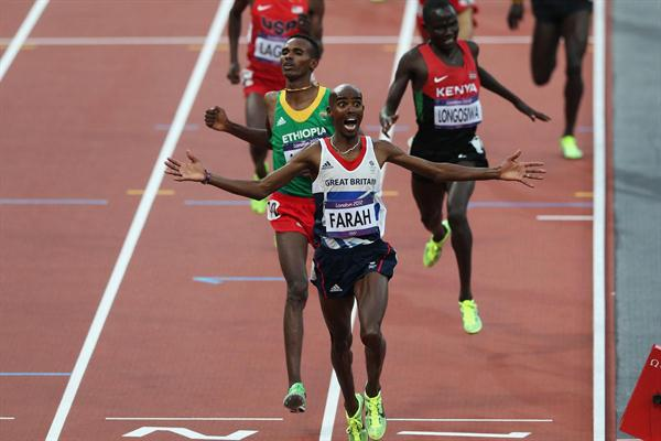 Mo Farah of Great Britain crosses the finish line to win gold ahead of Dejen Gebremeskel of Ethiopia and Thomas Pkemei Longosiwa of Kenya in the Men's 5000m Final on Day 15 of the London 2012 Olympic Games  on August 11, 2012 (Getty Images)