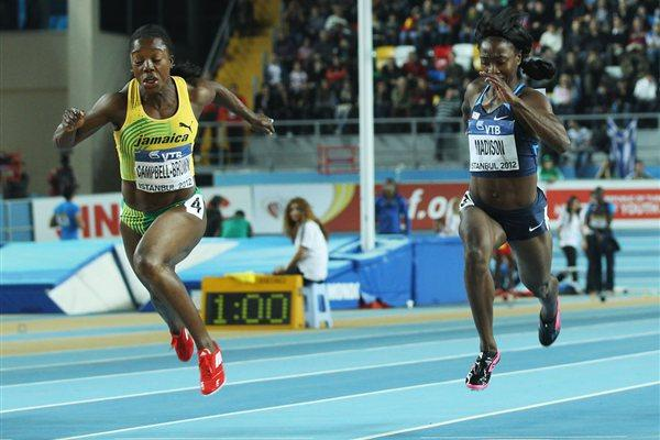 Veronica Campbell-Brown of Jamaica crosses the line to win gold ahead of bronze medalist Tianna Madison of the United States in the Women's 60 Metres Final during day three - WIC Istanbul (Getty Images)