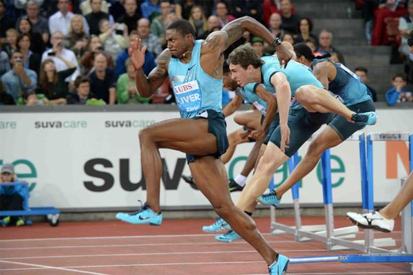 David Oliver on his way to victory in the 110m Hurdles at the 2013 IAAF Diamond League meeting in Zurich (Jiro Mochizuki)