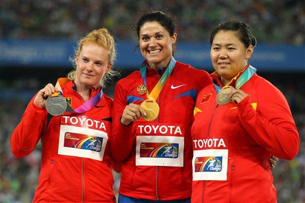 Tatyana Lysenko of Russia celebrates with her gold medal, Betty Heidler of Germany her silver and Wenxiu Zhang of China her bronze in the medal ceremony for the women's hammer throw final  (Getty Images)