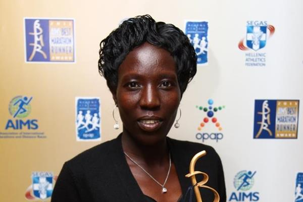 Edna Kiplagat with her AIMS Best Marathon Runner of the Year 2013 award (AIMS)