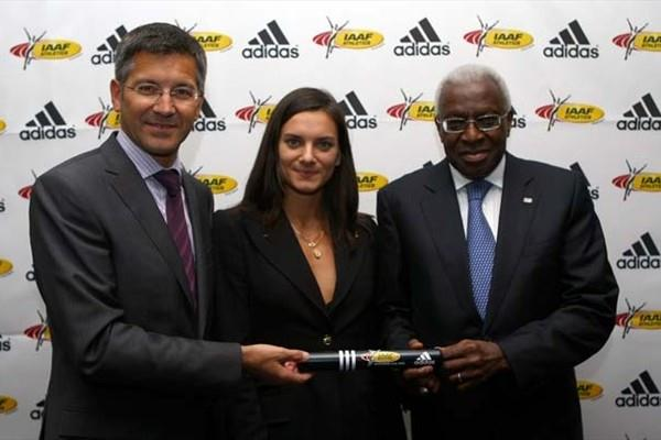 Herbert Hainer, CEO of adidas with Yelena Isinbayeva, and IAAF President Lamine Diack - 23 November 2008, adidas' 11 year contract with the IAAF (Getty Images)