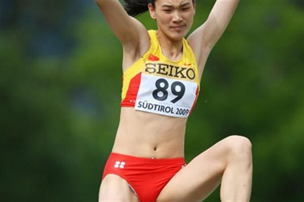 Minjia Lu of China on her way to winning the Girls' Long Jump (Getty Images)