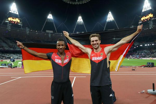 Silver medalist Bjorn Otto (R) of Germany celebrates with bronze medalist Raphael Holzdeppe of Germany after the Men's Pole Vault Final on 10 August 2012 (Getty Images)
