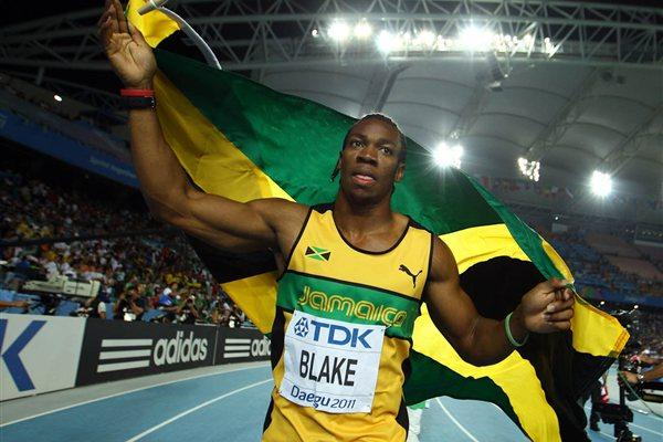 Yohan Blake of Jamaica celebrates with his country's flag after winning the men's 100 metres final during day two (Getty Images)