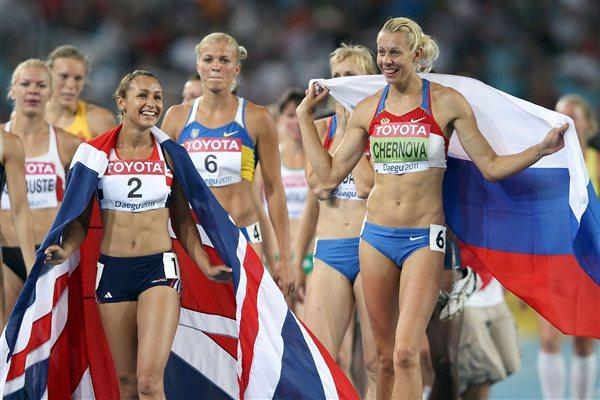 Gold medalist Tatyana Chernova (R) of Russia and silver medalist Jessica Ennis of Great Britain celebrate after competing in the 800 metres in the women's heptathlon (Getty Images)