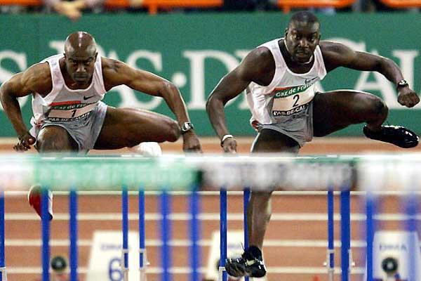 Ladji Doucoure (FRA) beats Allen Johnson (USA) in a French 60mH record in Lievin (AFP/Getty Images)