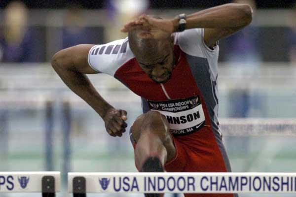 Allen Johnson in the 60m Hurdles heats at the 2004 USATF Indoor champs (Kirby Lee)