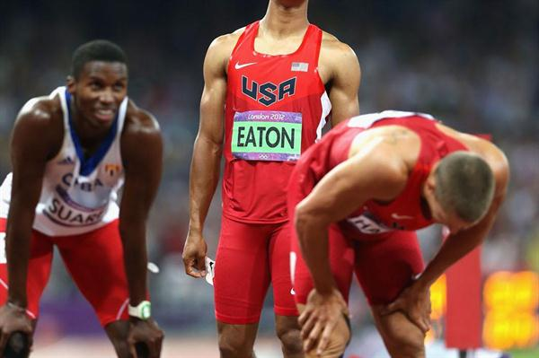 The three medallists (L-R) Leonel Suarez of Cuba (bronze medal), Ashton Eaton of USA (Gold medal)  and Trey Hardee of USA (Silver medal) react after competing in the Men's Decathlon 1500m of the London Olympic Games 2012 on 9 August 2012 (Getty Images)