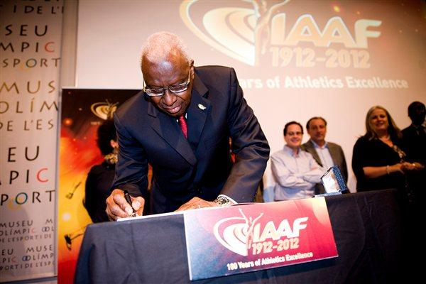 IAAF President Lamine Diack sgning the Honoured Guest Book of the IAAF Centenary Historic Exhibition (Getty Images)