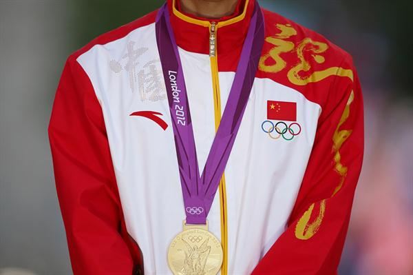 Ding Chen of China celebrates his gold medal in the Men's 20k Walk on Day 8 of the London 2012 Olympic Games at Olympic Stadium on August 4, 2012 (Getty Images)