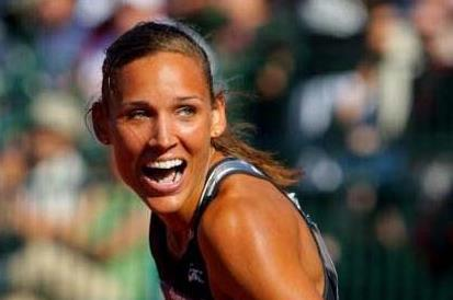 Lolo Jones looks astonished at the time after her 12.29 sec windy 100m Hurdles win at US Olympic Trials (Getty Images)