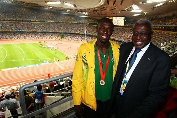 Usain Bolt and Lamine Diack and the backdrop of a full to capacity Olympic stadium in Beijing (Getty Images)