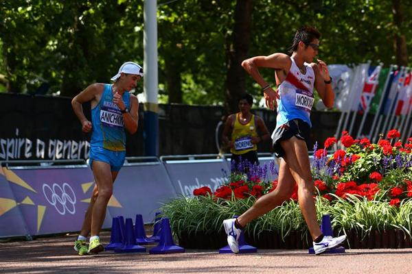 Vitaliy Anichkin of Kazakhstan and Koichiro Morioka of Japan compete during the Men's 50km Walk of the London 2012 Olympic Games on the streets of London (Getty Images)