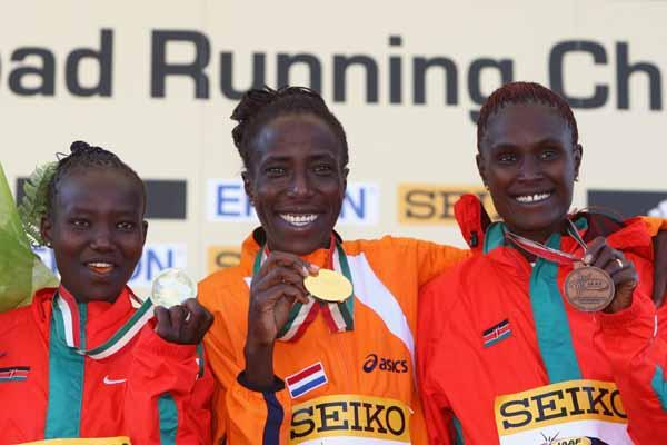 Lornah Kiplagat of the Netherlands celebrates her world record and victory in the women's race with silver medalist Mary Jepkosgei Keitany of Kenya and bronze medalist Pamela Chepchumba of Kenya (Getty Images)