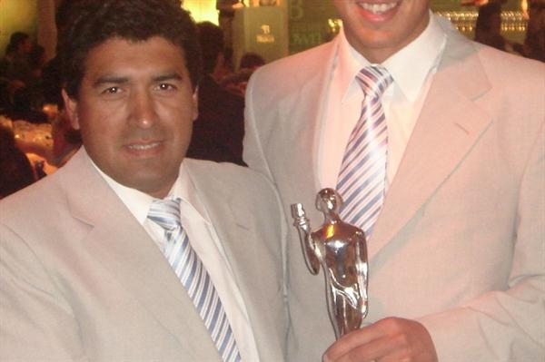 Braian Toledo, the Youth Olympic Javelin Throw champion (r), with his coach Gustavo Osorio (Olimpia Awards Organisers)
