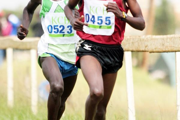 Joel Kemboi Kimurer trails Sammy Kitwara in the 12-kilometre race at the 2009 Kenya Police National Cross Country Championships at the Ngong Racecourse in Nairobi. Kimurer won the race. (Elias Makori)