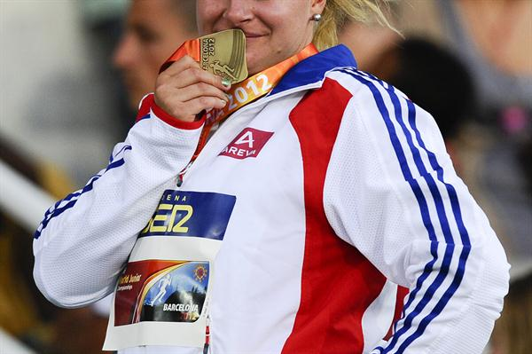 Alexandra Tavernier of France poses with her medal on the podium during the medals ceremony of the Women's Hammer Throw Final on the day five of the 14th IAAF World Junior Championships in Barcelona on 14 July 2012 (Getty Images)