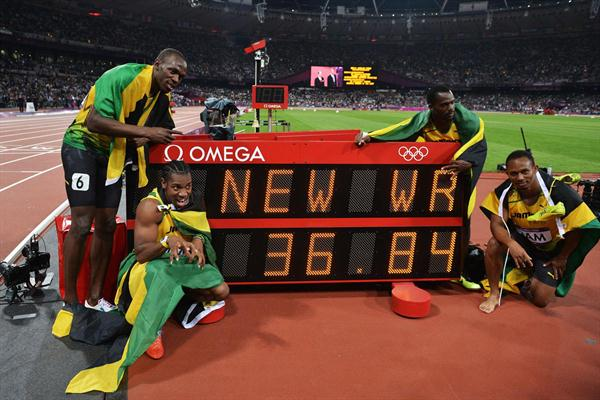 Winning Jamaican team: Usain Bolt, Yohan Blake, Michael Frater and Nesta Carter next to the clock showing the new world record of 36.84 in the Men's 4 x 100m Relay Final of the London 2012 Olympic Games on August 11, 2012  (Getty Images)