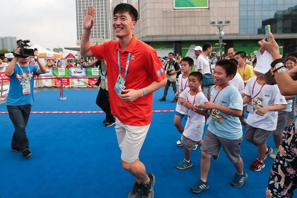 Sprint hurdler Liu Xiang at the IAAF Kids' Athletics event in Nanjing (Getty Images)