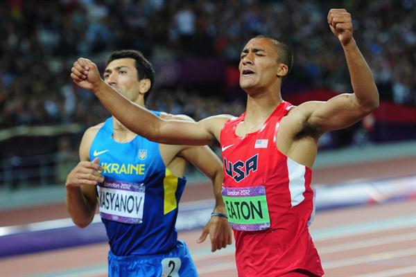 Ashton Eaton of the United States enjoying his first place as he crosses the finish line next to Oleksiy Kasyanov of Ukraine in the Men's Decathlon 1500m  of the London 2012 Olympic Games on 9 August 2012 (Getty Images)