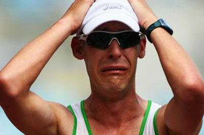 Nathan Deakes crossing the line in the 50Km Walk in Osaka (Getty Images)